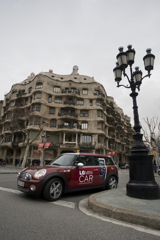 The LG Mini car driving around the beautiful, unique architecture of Barcelona