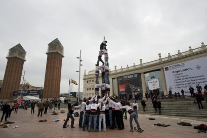 Participants perform one of Catalonia's world-famous human towers next to the Venetian Towers at Plaza Españaat as part of the LG Mini Social event in Barcelona.