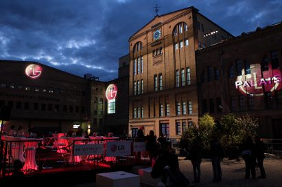 Three gigantic 3D LG logos projected onto the front wall of buildings in Kulturbrauerei, the cultural heart of Berlin