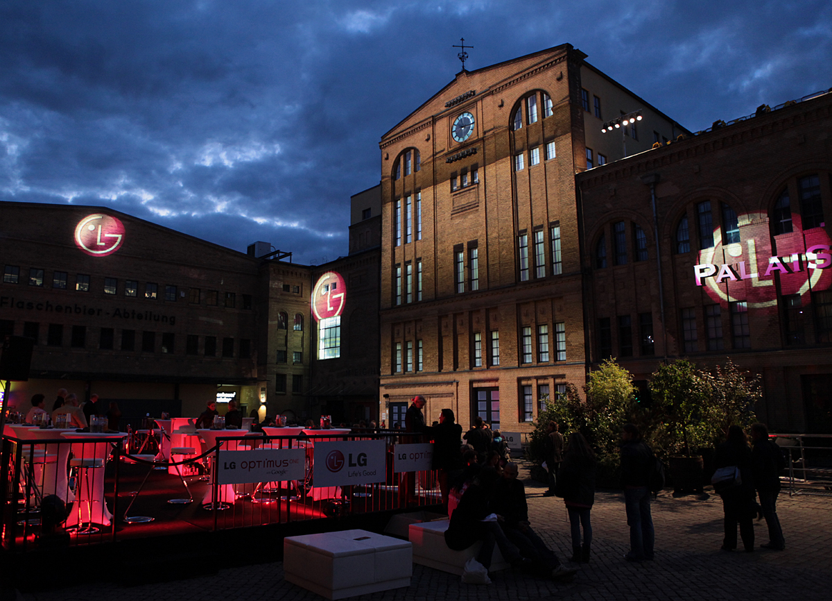 Three gigantic 3D LG logos projected onto the front wall of buildings in Kulturbrauerei, the cultural heart of Berlin.