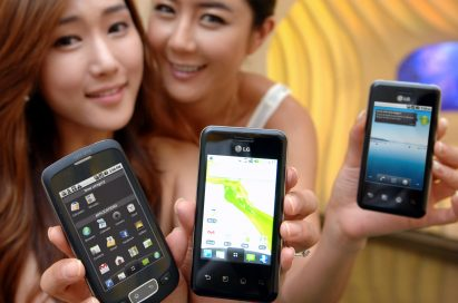 Two models hold up two variants of the LG Optimus Chic and one of the LG Optimus One side-by-side.