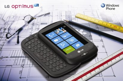 Windows Phone promo shot of The LG Optimus 7Q with slidable keyboard open laid on an architect's building blueprint, surrounded by rulers, a pencil and a pair of glasses.