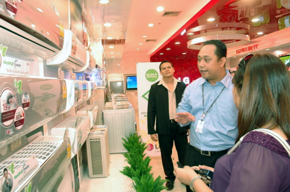 A gentleman explains how LG's air conditioners are the healthiest on the market in front on numerous offerings from LG.