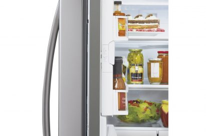 Side close-up view of LG new Four-Door French-Door refrigerator's door bin space closed