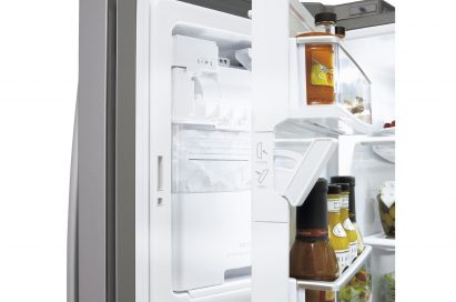 Side close-up view of LG new Four-Door French-Door refrigerator's door bin space opened showing its Slim SpacePlus™ Ice System