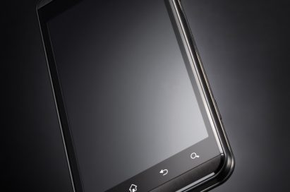 A 45 degrees counter-clockwise view of the LG Optimus 3D with black in the background