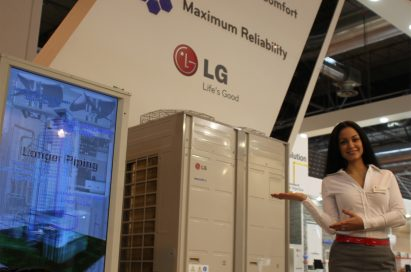 A woman posing in front of LG's commercial air conditioning appliances