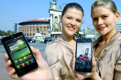 Two female models hold LG Optimus 2Xs and show its front views