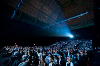 Approximately 1,500 guests watching a screening of the new 3D movie Rio on a massive 27m x 11m screen at the Le Grand Palais in Paris'