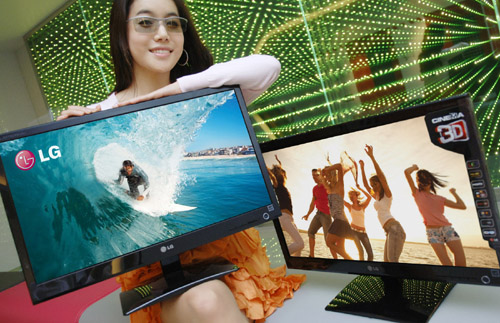 A model wearing 3D glasses presents two LG Cinema 3D Monitors.