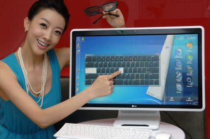 A model is posing with the LG all-in-one PC model V3001