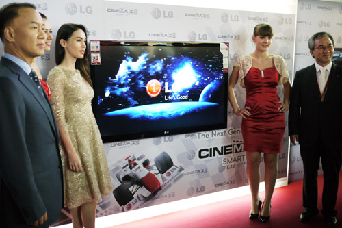 Famous actress Megan Fox and LG executives pose with the LG CINEMA 3D TV at Ferrari World in Abu Dhabi.
