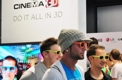 Three visitors wearing 3D glasses at the LG 3D Game Festival booth in Gamescom