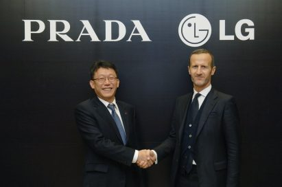 Won-bok Bae, Vice President of Product Strategy Group at LG Electronics Mobile Communications Company and a representative of PRADA Group are shaking hands