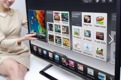 A model is demonstrating the newest Smart TV features with a 2012 LG CINEMA 3D Smart TV