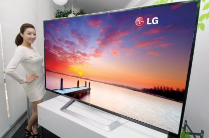 A model poses next to the world's largest 84-inch 3D Ultra Definition TV