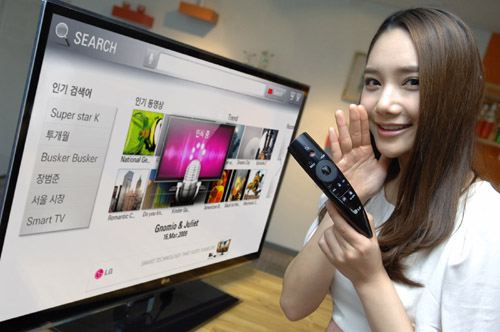 A model demonstrates LG's new Magic Remote with LG's CINEMA 3D Smart TV.