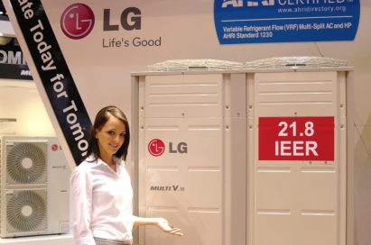 Another view of a woman posing in front of the LG Multi V III air conditioner