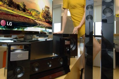A model poses with LG 3D SOUND HTS and the LG CINEMA 3D Smart TV