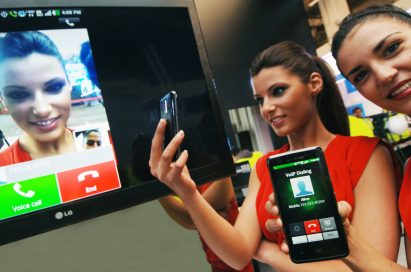Two models demonstrating the world's first voice-to-video conversion over an LTE network via LG smartphones