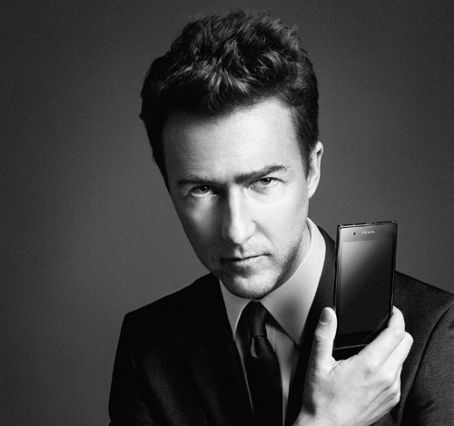 American actor Edward Norton holds up the PRADA phone by LG 3.0 with its front showing