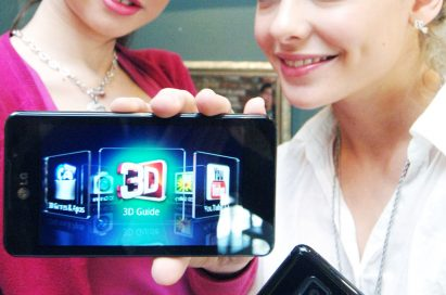 Another view of two female models holding LG's Optimus 3D Max at its launch event