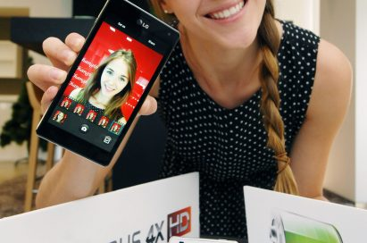 A female model holds a black LG Optimus 4X HD behind the logos of LG Optimus 4X HD and SiO technology, while a front view of the white LG Optimus 4X HD stands at the front