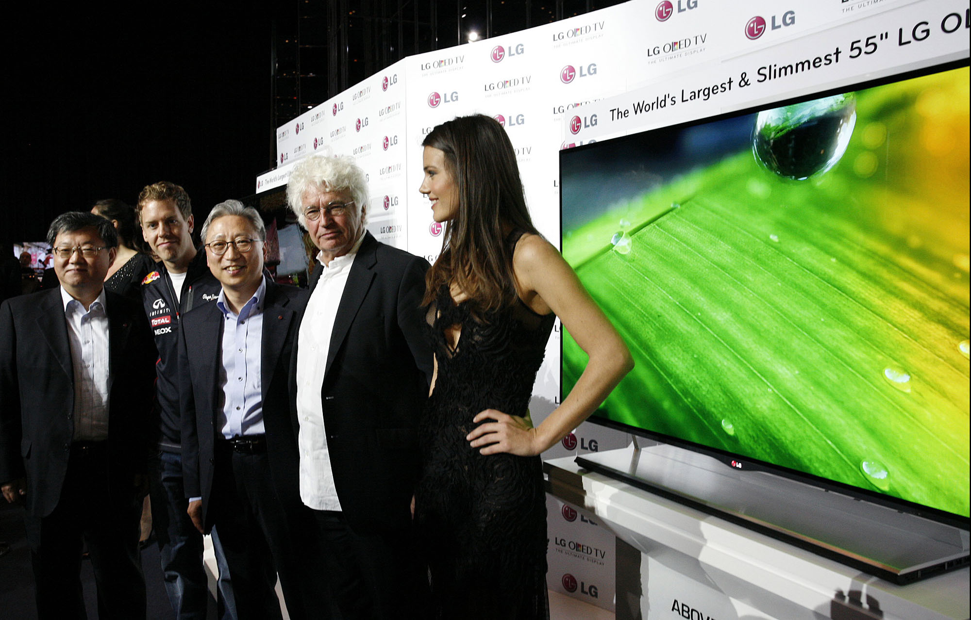 From left to right: LG's vice president of Overseas TV Sales and Marketing Ki-il Kwon, F1 Champion Sebastian Vettel, LG Europe Head Stanley Cho, film director Jean-Jacques Annaud and model Gemma Sanderson pose in front of LG's 55-inch OLED TV in Monaco.