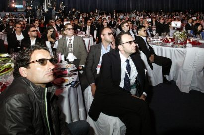 Attendees wearing 3D glasses to watch a 3D video on LG's new OLED TVs at Salle des Etoiles in Monaco.