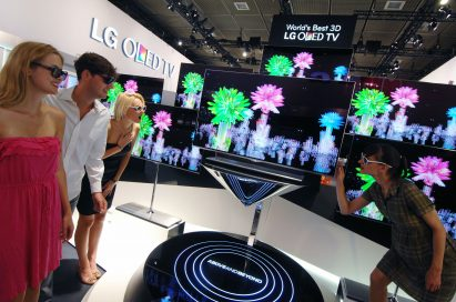 Visitors to LG's booth experiencing the company's 3D OLED TVs at IFA 2012