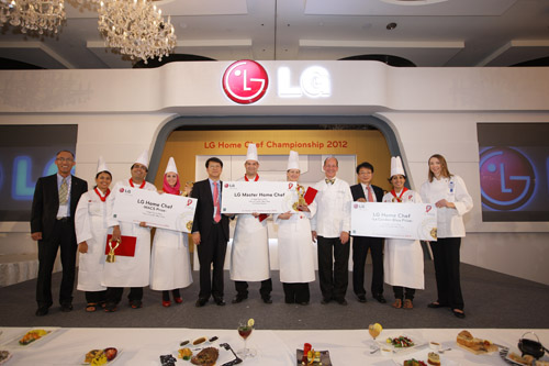 Winners of the fifth annual LG Home Chef Championship accept their awards on stage with LG representatives