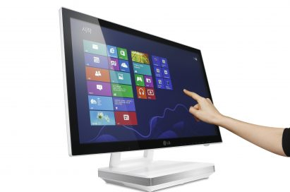 The LG All-In-One PC model V325's display being interacted with by someone's hand