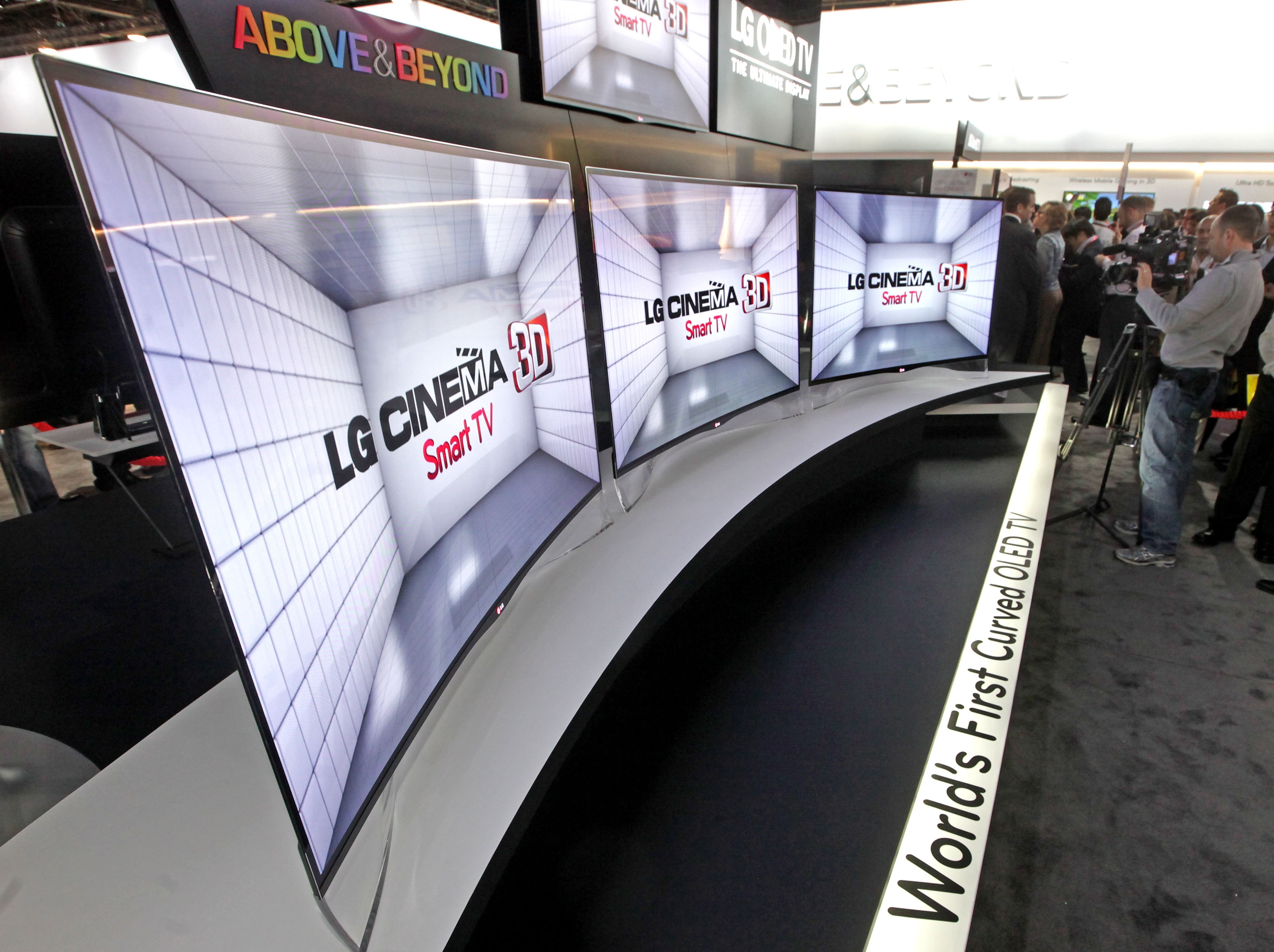 LG displaying the world's first curved OLED TVs (model EA980) at CES 2013