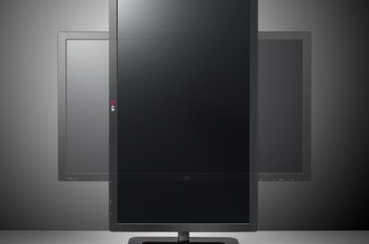 LG EA83 ColorPrime IPS Monitor rotating in front of a grey background