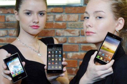 Two female models are holding LG Optimus L Series smartphones