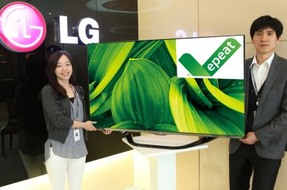 Two LG employees holding up an LG TV displaying the EPEAT logo