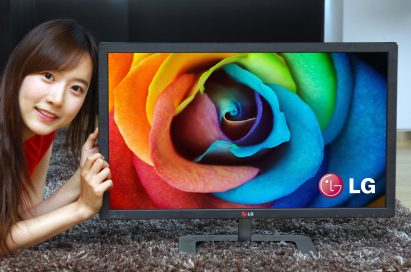 A model posing with LG ColorPrime Monitor model 27EA83