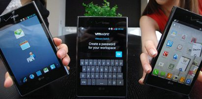Three Optimus Vu:s showing different screens – two of them are held by models and the other one is displayed on a table.