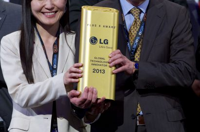Kim Eun-jung, director of LG Electronics and Song Ki-ju, CEO of LG Electronics Germany hold the PLUS X Award together