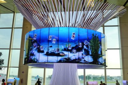 "64 47-inch LG 47WV30 displays in the form of a cylindrical video wall completes the ""Social Tree"" installation at Changi Airport's Terminal One"
