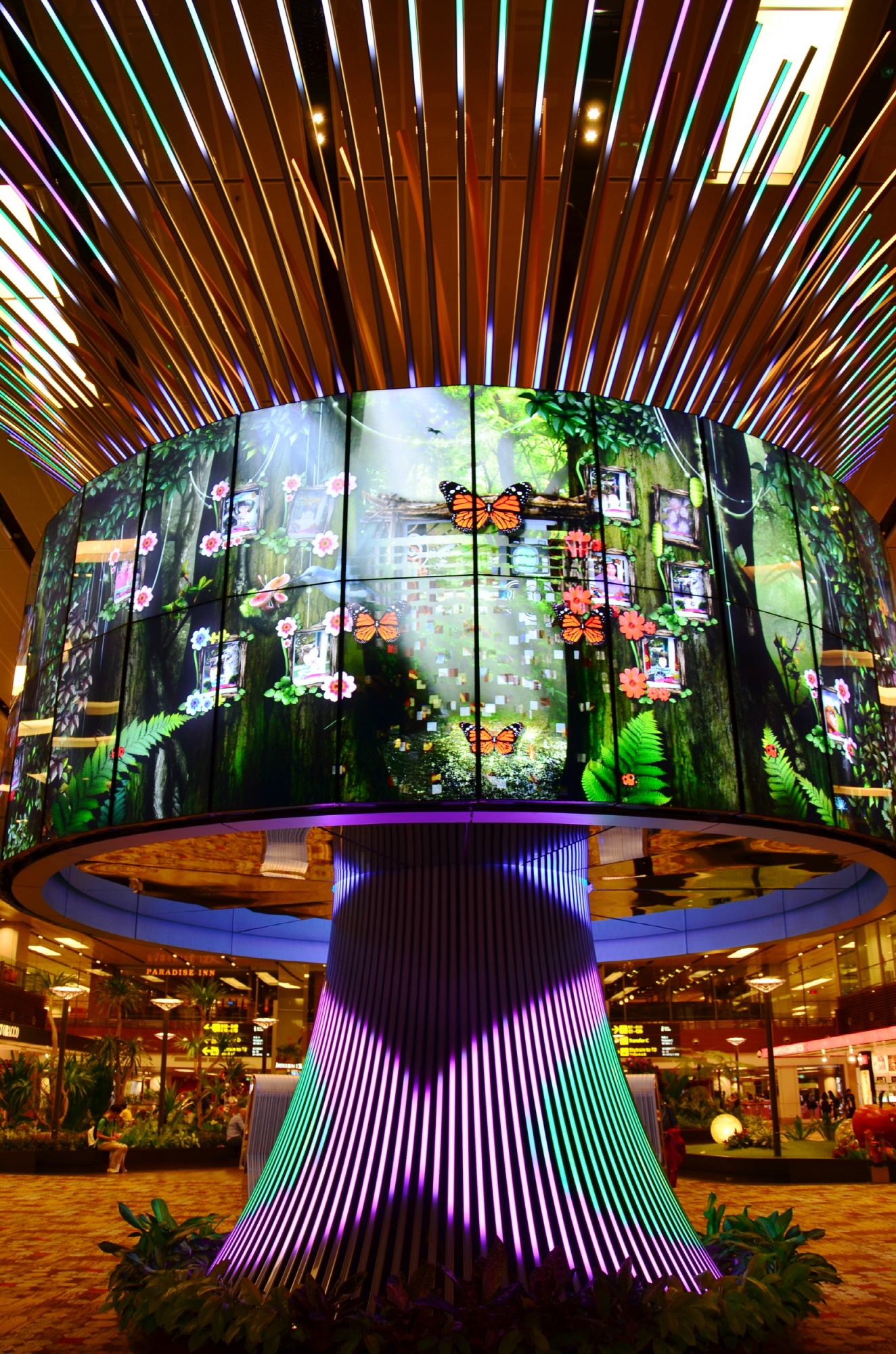 Numerous LG 47WV30 displays create a 'Social Tree' video wall that display vivid images in Changi Airport's Terminal One