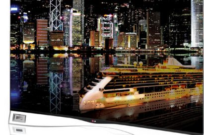 A right-side view of the LG's curved OLED TV model 55EA9800 displaying a night scene of the city
