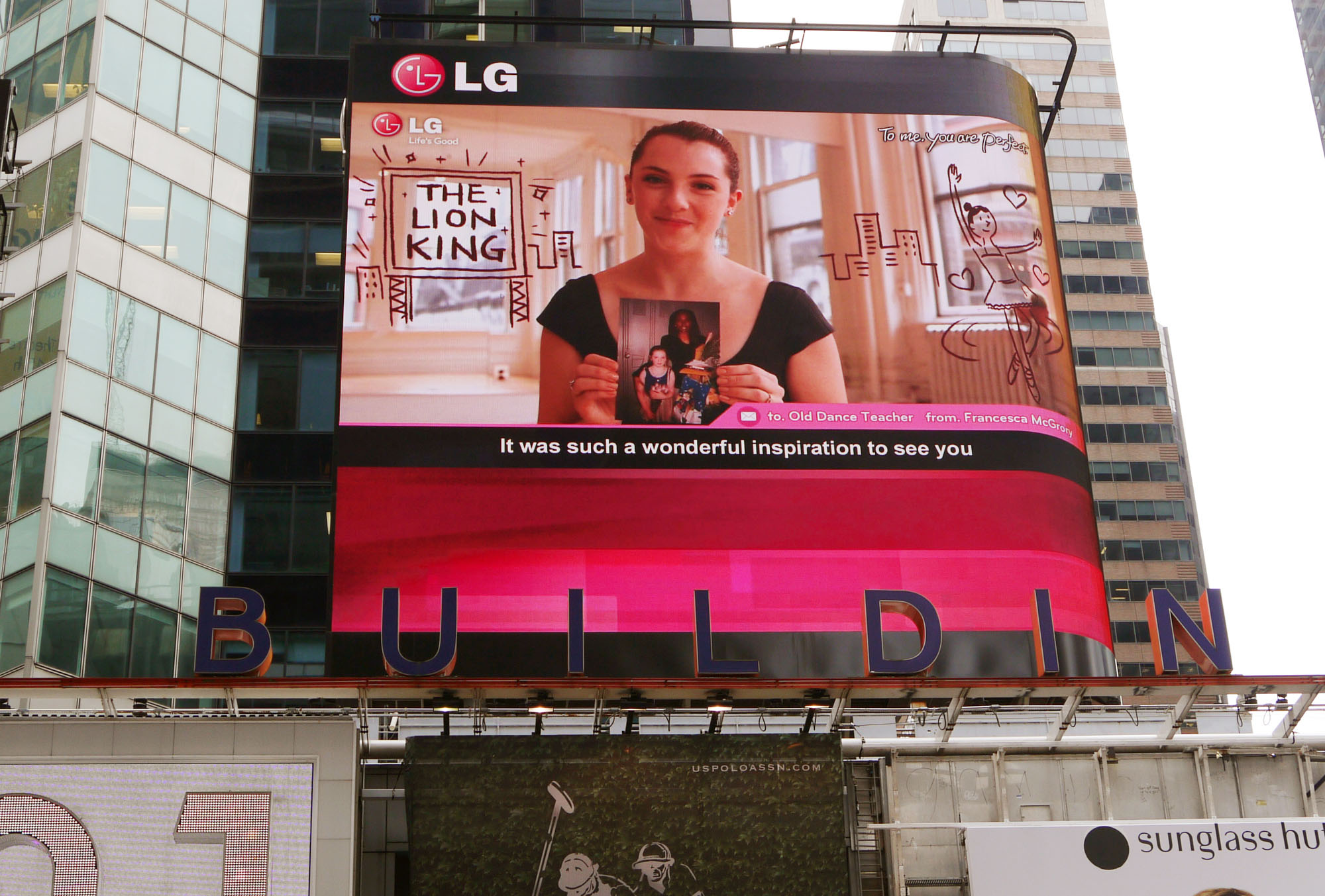 """A Times Square billboard saying """"To me, you are perfect. From G"""""""