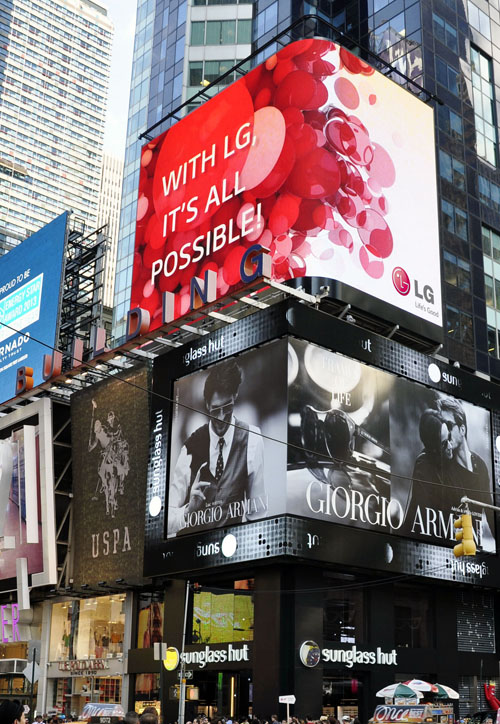 """LG's new brand identity, """"It's All Possible,"""" is advertised at the outdoor LED display."""