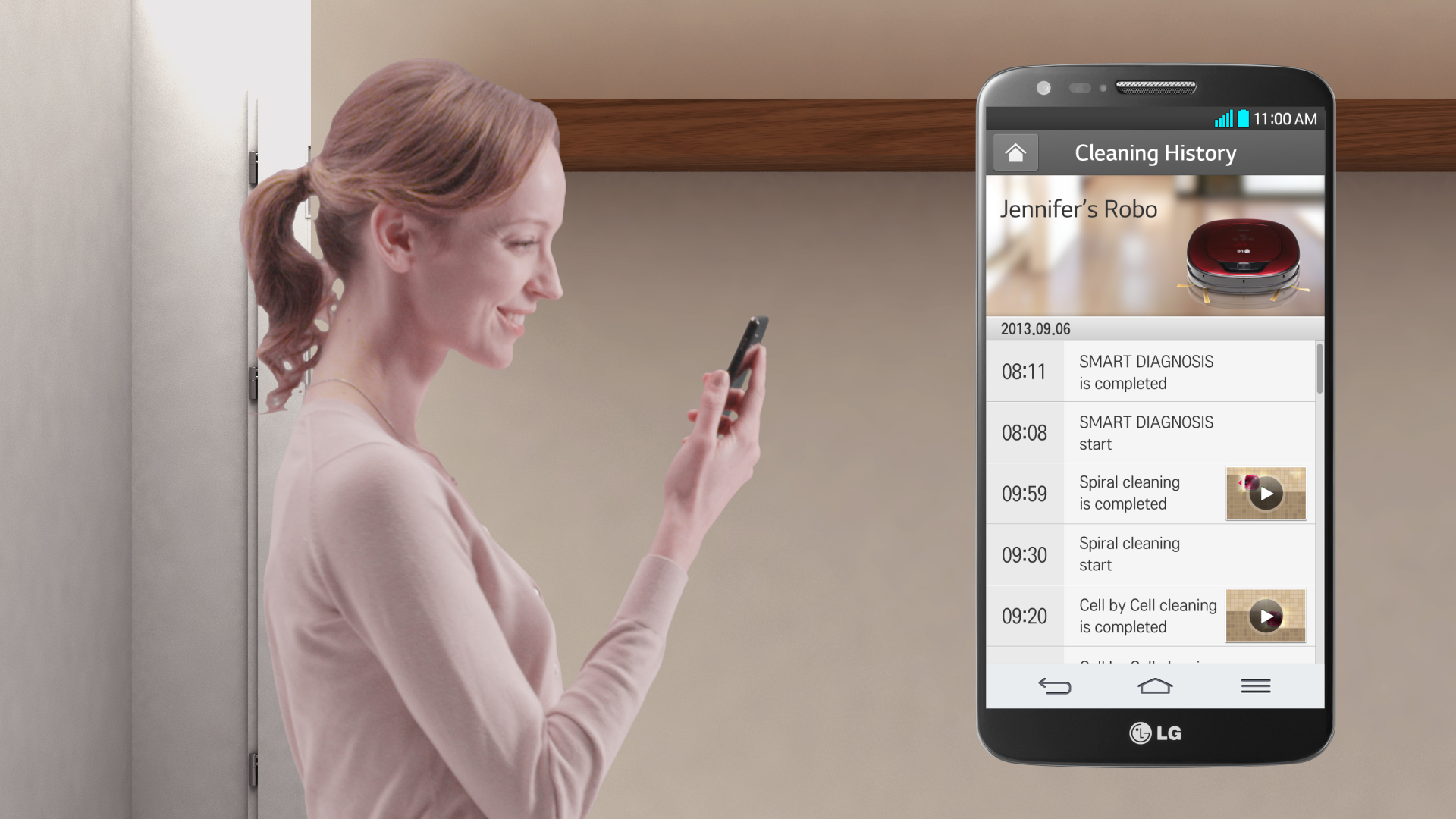A woman monitoring her LG HOM-BOT's cleaning history with the smart app