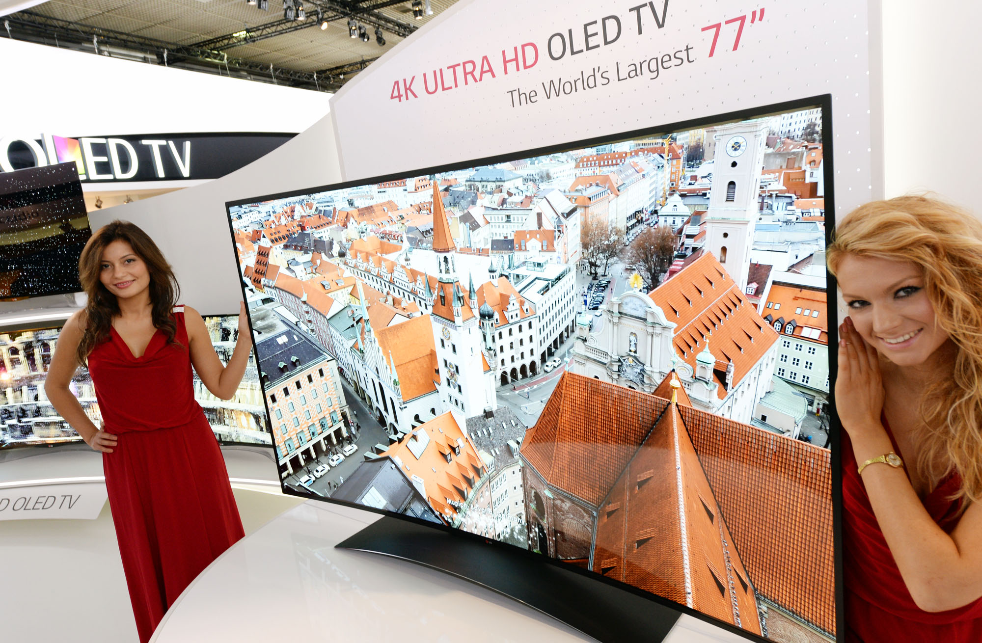Two models presenting the 77-inch ULTRA HD OLED TV at IFA 2013
