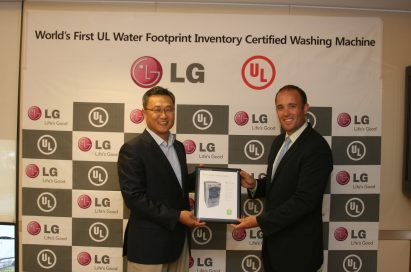 Chris Jung, president of Home Appliances at LG USA, and Sara Greenstein, president of UL Environment, holding the UL Environment certification for LG's ultra large-capacity front-load washing machine
