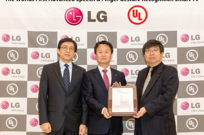 Three officials from LG and UL (Underwriters Laboratories) hold up a validation certificate from UL