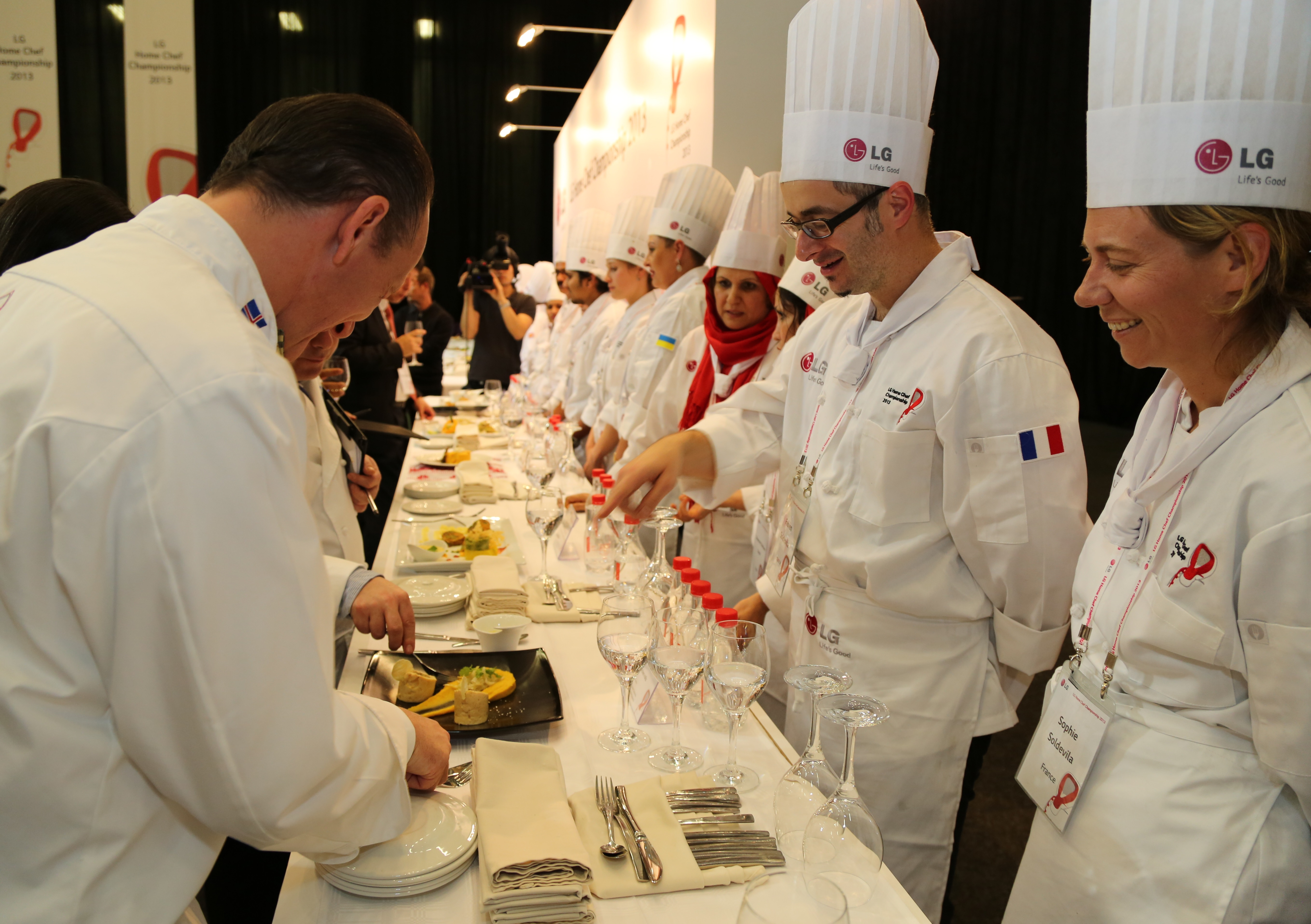 Participating chefs explain their dishes to the judges
