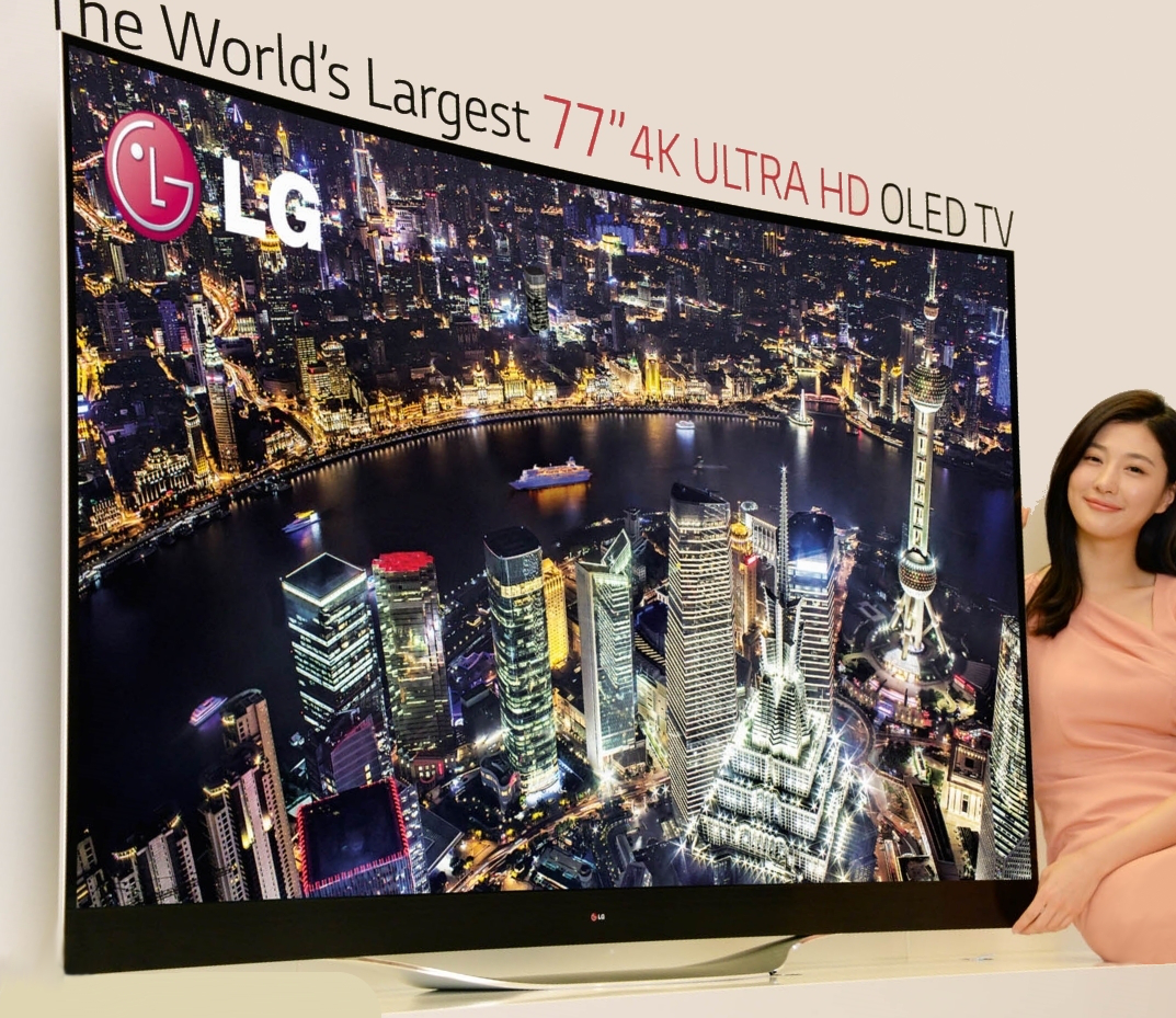 A model presenting LG's record-breaking 77-inch 4K ULTRA HD OLED TV